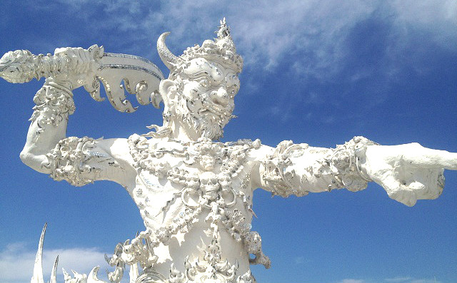 chiang rai white temple statue