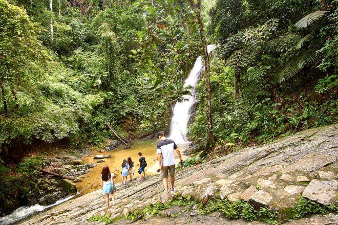 tourists at langkawi waterfall