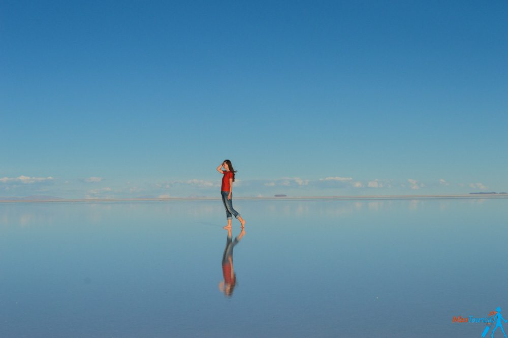 Salt flat reflection girl Bolivia