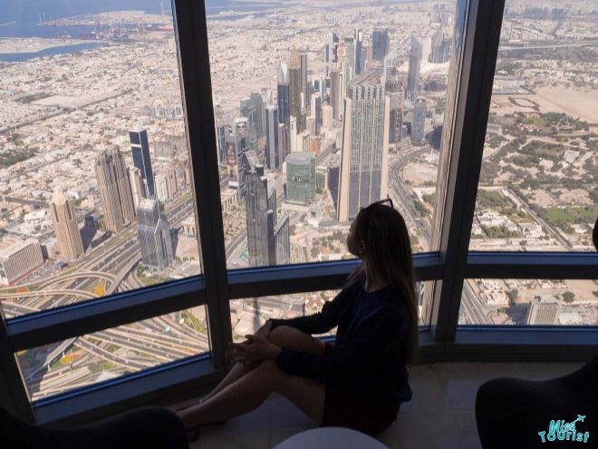 woman in front of burj khalifa window