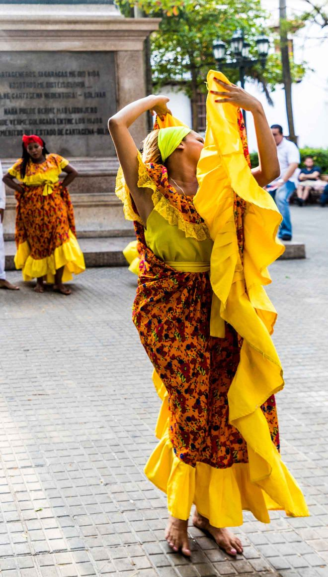 woman dancing yellow