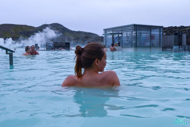 girl relaxing in blue lagoon