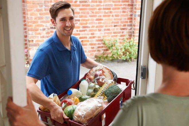 guy bringing groceries