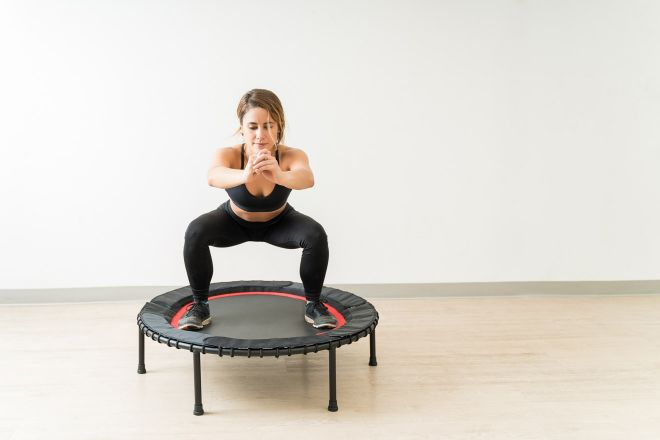 woman jumping on trampooline