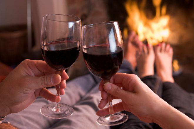 feet warming at fireplace